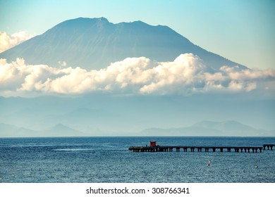 beautifull view on Bali from ocean, nusa penida island, vulcano in clouds with blue ocean and sky