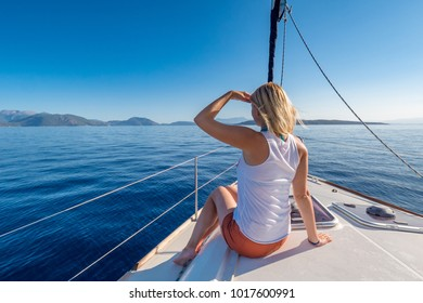 Beautifull young woman on a yacht at sea