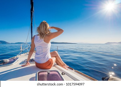 Beautifull young woman relaxing on a yacht at sea