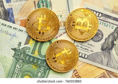 Beautifully arranged bills 100 dollar, 50, 100 euro and gold coins bitcoin on a gray background. Bitcoin cryptocurrency. Anonymous