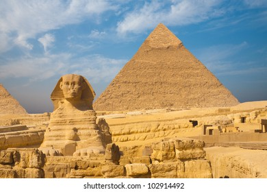 Beautifully clear blue sky behind the front face of the Great Sphinx and Khafre Pyramid side by side in Giza, Cairo, Egypt. Horizontal copy space