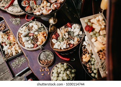 Beautifully decorated banquet table with different food snacks and appetizers on corporate birthday party event or wedding celebration