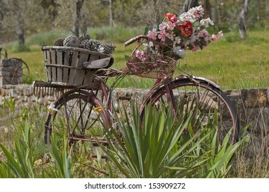 A beautifully decorated bike leaning against an old wall in provencal countryside, France