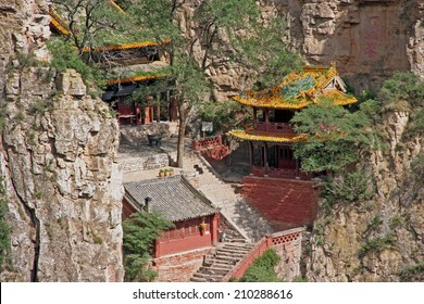 beautifully decorated buildings of hengshan taoist monastery in Shanxi Province near Datong, China, stylized and filtered to resemble an oil painting.