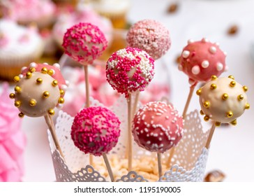Beautifully decorated cake pops on sweet table.