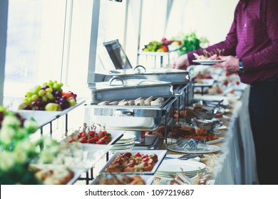 Beautifully decorated catering banquet table with variety of different food snacks and appetizers on corporate christmas birthday party event or wedding celebration