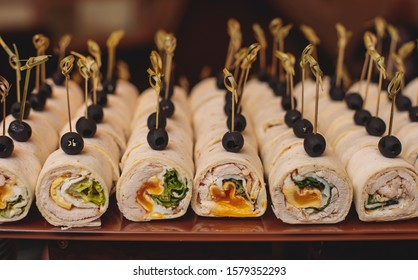 Beautifully decorated catering banquet table with different food snacks and appetizers on corporate christmas birthday party event or wedding celebration, different vegan vegetarian snacks