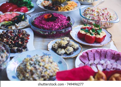 Beautifully decorated catering banquet table with different food snacks and appetizers assortment on corporate christmas party event celebration