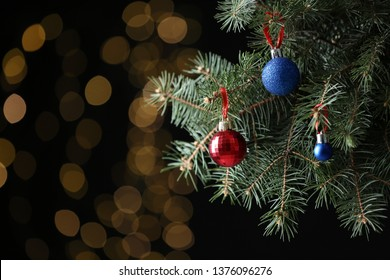 Beautifully decorated Christmas tree against blurred lights, space for text