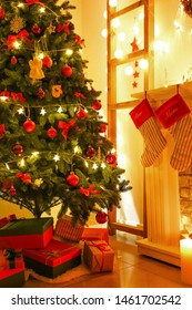 Beautifully decorated Christmas tree with gift boxes in room