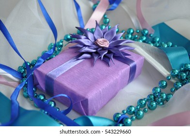 Beautifully decorated gifts. Tenderness and romance for your favorite. Beautiful packaging is decorated with satin ribbons and flowers are