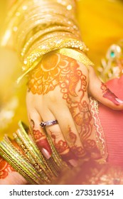 beautifully decorated hands of an Indian bride with henna