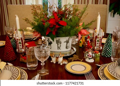 Beautifully decorated holiday dinner table with colorful centerpiece