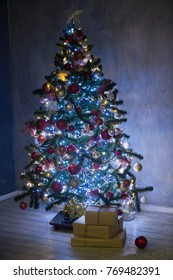 Beautifully decorated house with a tree and presents at Christmas. hristmas tree in lights.