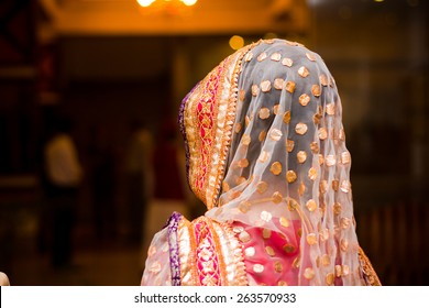 beautifully decorated Indian bride dress, Soft Focus.