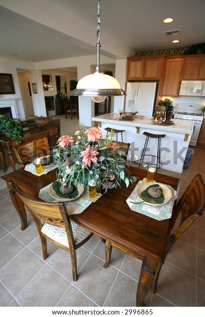 A beautifully decorated kitchen interior inside an upscale home