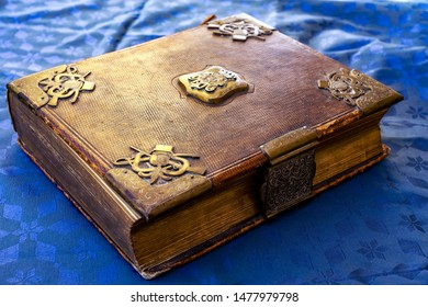 beautifully decorated old book brown gold with lock on blue background fairy tale book