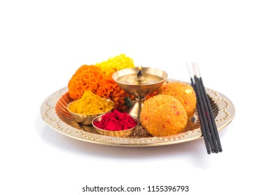 Beautifully Decorated Pooja Thali for festival celebration to worship, haldi or turmeric powder and kumkum, flowers, scented sticks in brass plate, hindu puja thali