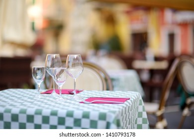 Beautifully decorated small outdoor restaurant tables in the city of Lerici, La Spezia, Italy