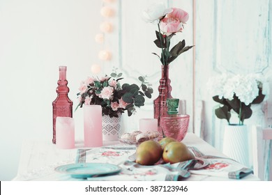 Beautifully decorated table adorned with flowers and pears