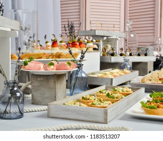 A beautifully decorated table with dishes and decorations for a buffet or a banquet
