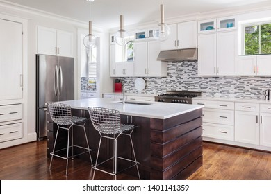 Beautifully designed upscale modern kitchen with the lights off