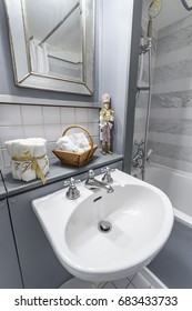 beautifully dressed modern light bathroom in grey