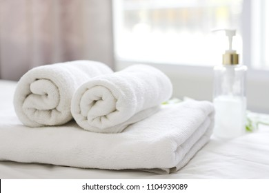 Beautifully folded white towels and toiletries. Luxury bedroom in the bedroom - Stock Photo Bed, hotel, bedroom, hotel room, towel, liquid soap