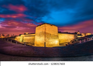 Beautifully illuminated Bahrain Fort before sunrise. Bahrain Fort is part of UNESCO World Heritage.