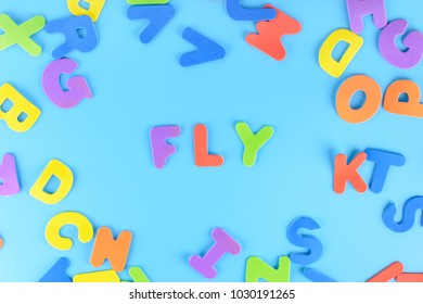 Beautifully laid out inscription fly of multi-colored letters. Blue background.