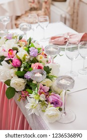 Beautifully laid table decorated with flowers