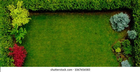 Beautifully landscaped small patio garden top view with no people and empty space.