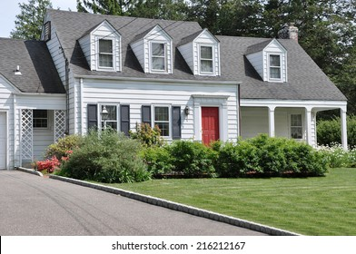 Beautifully Landscaped Suburban Cape Cod Colonial Style Home Sunny Residential Neighborhood USA