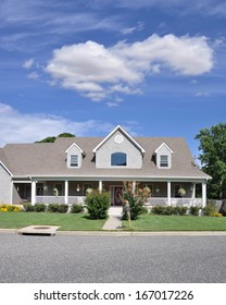Beautifully Landscaped Suburban Home with flowers Plants Sunny Blue Sky Clouds Residential Neighborhood USA