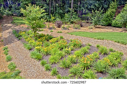 A beautifully landscaped yard on a slopping lot.