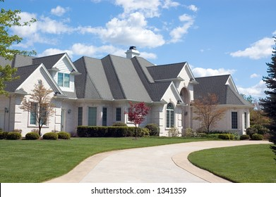 Beautifully, large and expensive  new home. This house features lots of roof peaks and a circular driveway. Just one of many new home or house photos in my gallery.