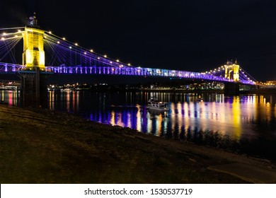 Beautifully Lit Roebling Suspension Bridge Connecting Cincinnati, Ohio to Covington in Northern Kentucky as part of the BLINK art, light and technology festival