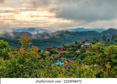 Beautifully Lit View of Traditional Akha Hill Tribe Village on Mountain Top Ridge in Nam Ha National Protected Area. Ethnic Village in Laotian with Dramatic Morning Sunrise (Luang Namtha, Laos).