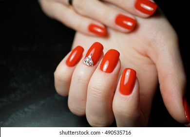Beautifully made nails manicure with gel polish applying.
