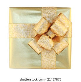 Beautifully packed golden gift box isolated on white