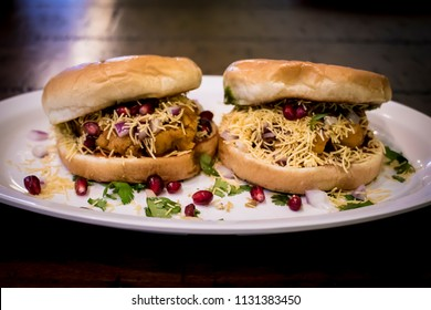 Beautifully Plated Dabeli Indian Food with Pomegranate Seeds and Cilantro Served at Navratri
