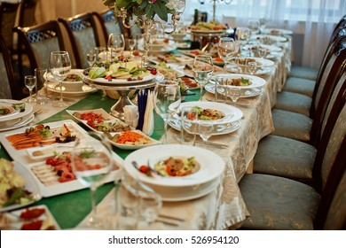 Beautifully served banquet table with cold snacks. wedding reception