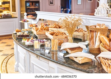 Beautifully served freshly baked pastry, luxury hotel breakfast buffet isolated, restaurant interior