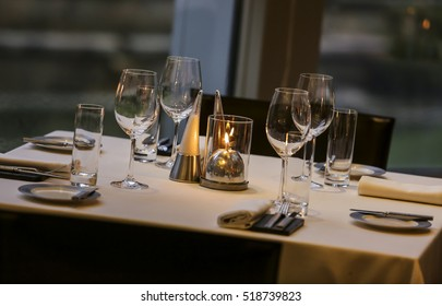 Beautifully set dinner table in a restaurant.