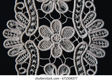 Beautifully shaped laces on black.