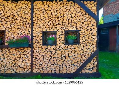 Beautifully stacked firewood in backyard.
