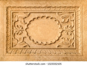 Beautifully stone carved decorative plaque or banner with empty space at centre.