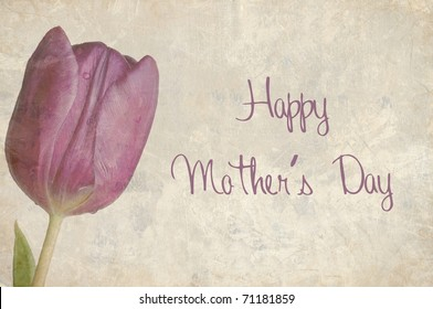 A Beautifully Textured Card with a Single Purple Tulip with the Text Happy Mother's Day written on it.