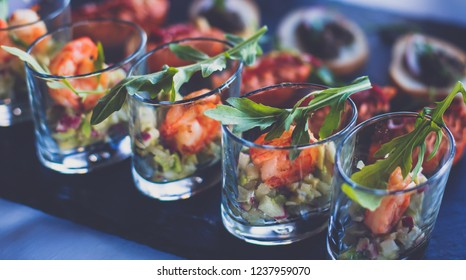 Beautifully vibrant view of decorated catering banquet table with different food snacks and appetizers on corporate christmas birthday party event or wedding celebration