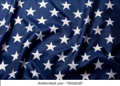Beautifully waving stars of American flag close up background.